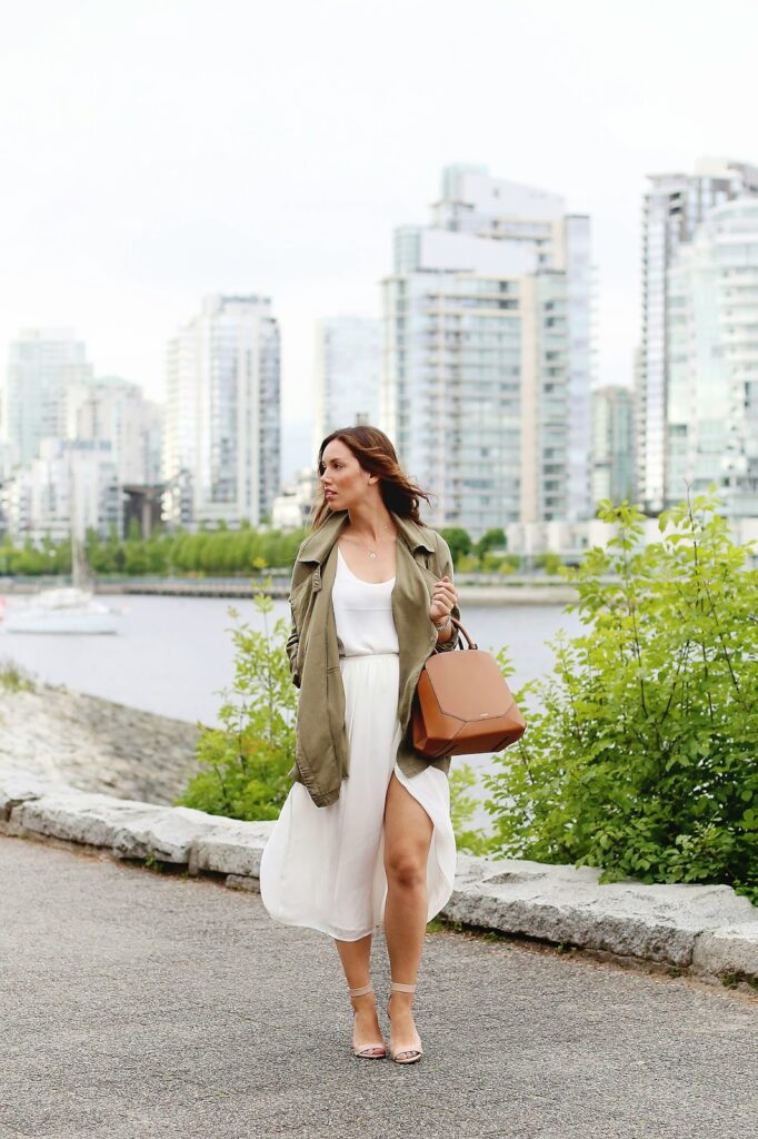 to vogue or bust, vancouver style blog, vancouver fashion blog, vancouver lifestyle blog, vancouver health blog, vancouver fitness blog, vancouver travel blog, canadian fashion blog, canadian style blog, canadian lifestyle blog, canadian health blog, canadian fitness blog, canadian travel blog, alexandra grant, aritzia silk skirt, gentle fawn utility jacket, aritzia auxiliary bega bag, j.crew lanie stacked heels, keltie leanne bracelet, kv bijou arie bracelet, keltie leanne designs necklace, wavy brown hair, best hair stylists in vancouver, vancouver sea wall, how to style a utility jacket, how to style a side slit skirt, best fashion blogs, best style blogs, best lifestyle blogs, best travel blogs, best health blogs, best fitness blogs, top fashion blogs, top style blogs, top lifestyle blogs, top travel blogs, top health blogs, top fitness blogs