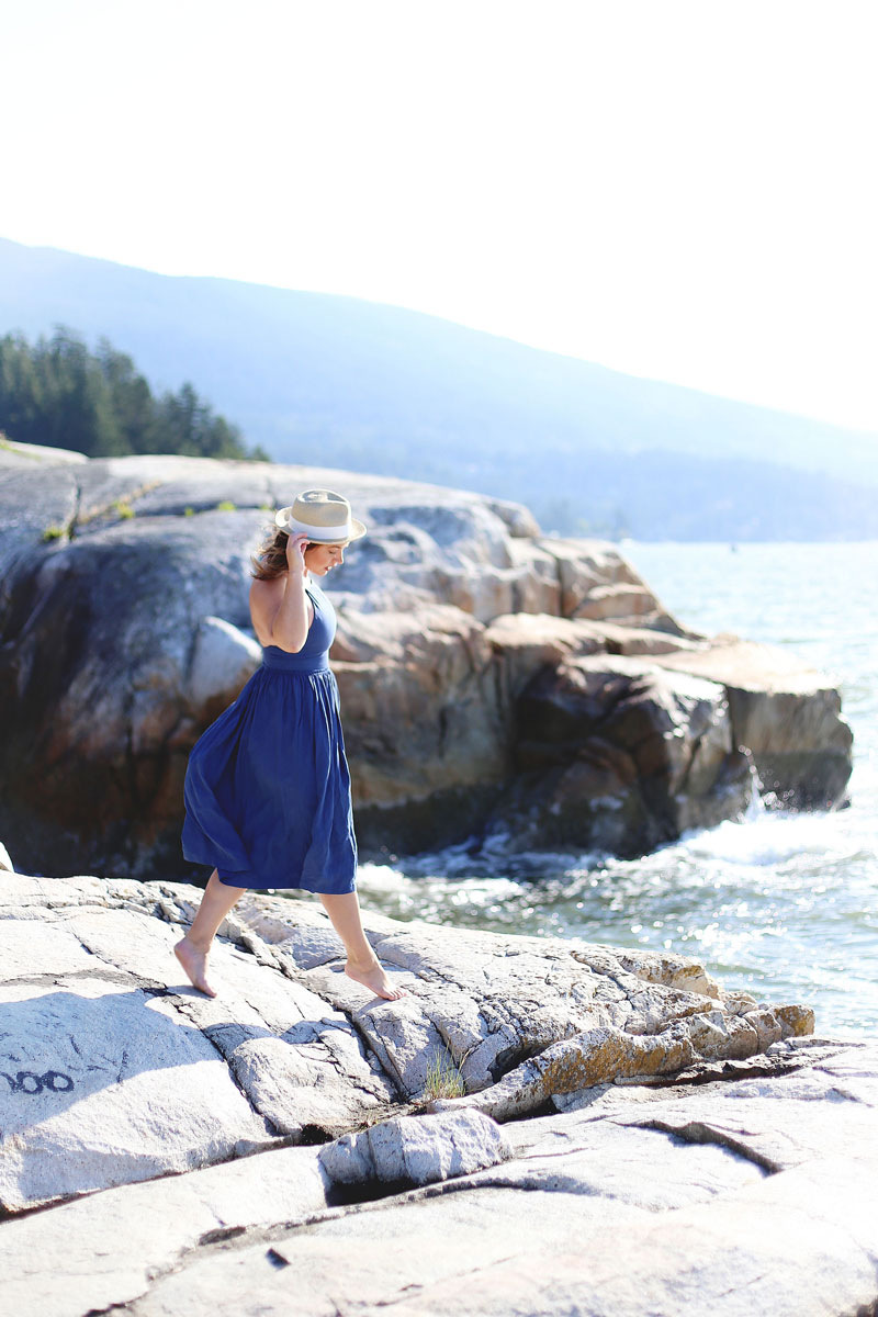 To Vogue or Bust wearing Wilfred by Aritzia dress and straw hat at Lighthouse Park, Vancouver, Canada