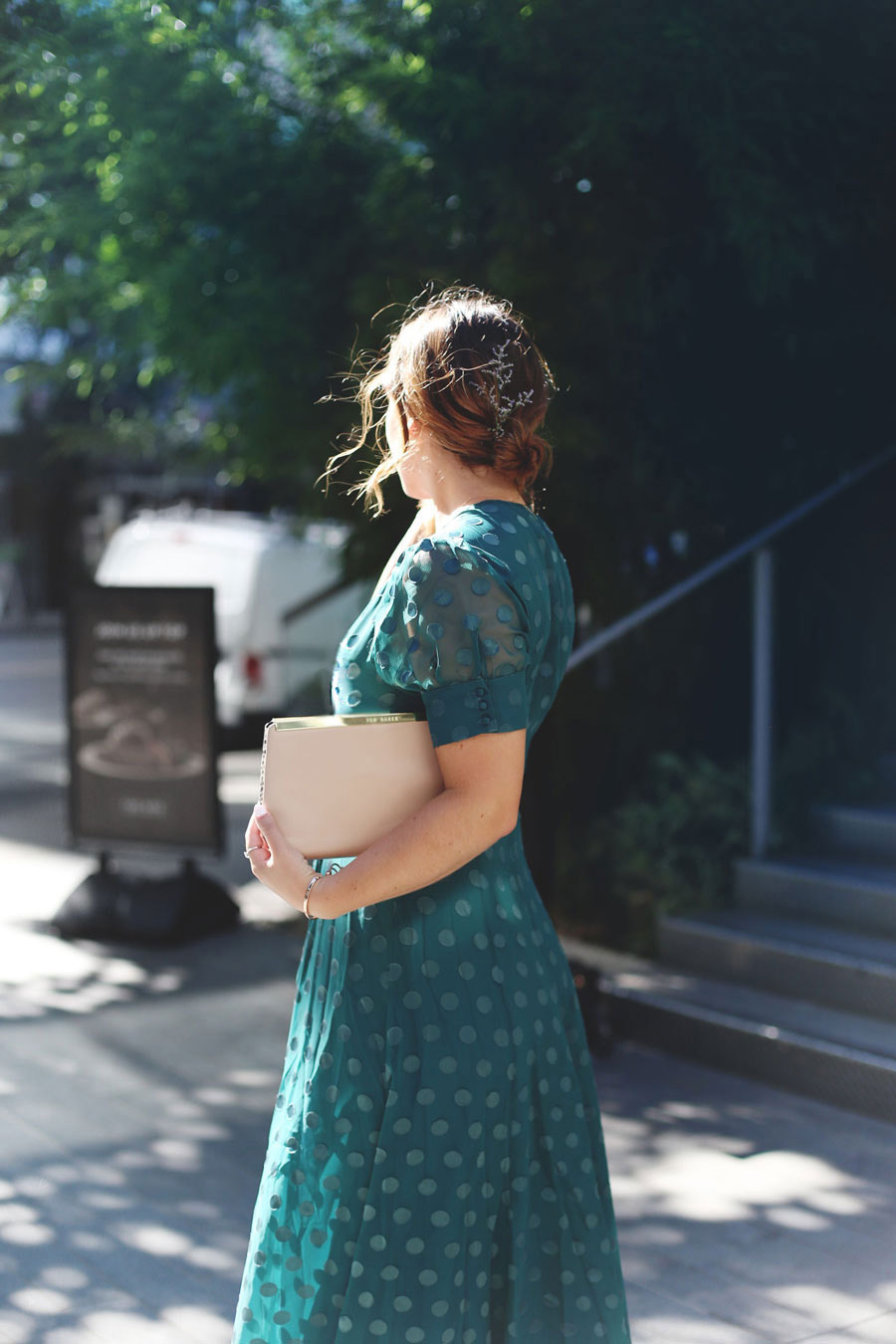 To Vogue or Bust shares what to wear to a black tie wedding in a TULAROSA by Revolve green maxi dress and Ted Baker clutch
