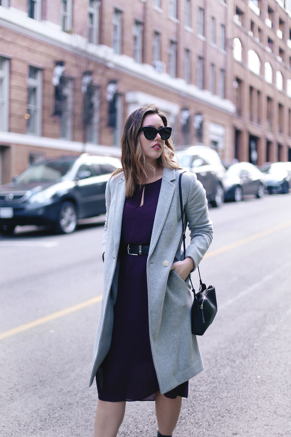 How to transition your style from winter into spring in an Aritzia dress, Aritzia wool coat, Aritzia black leather bag, Frye ankle boots