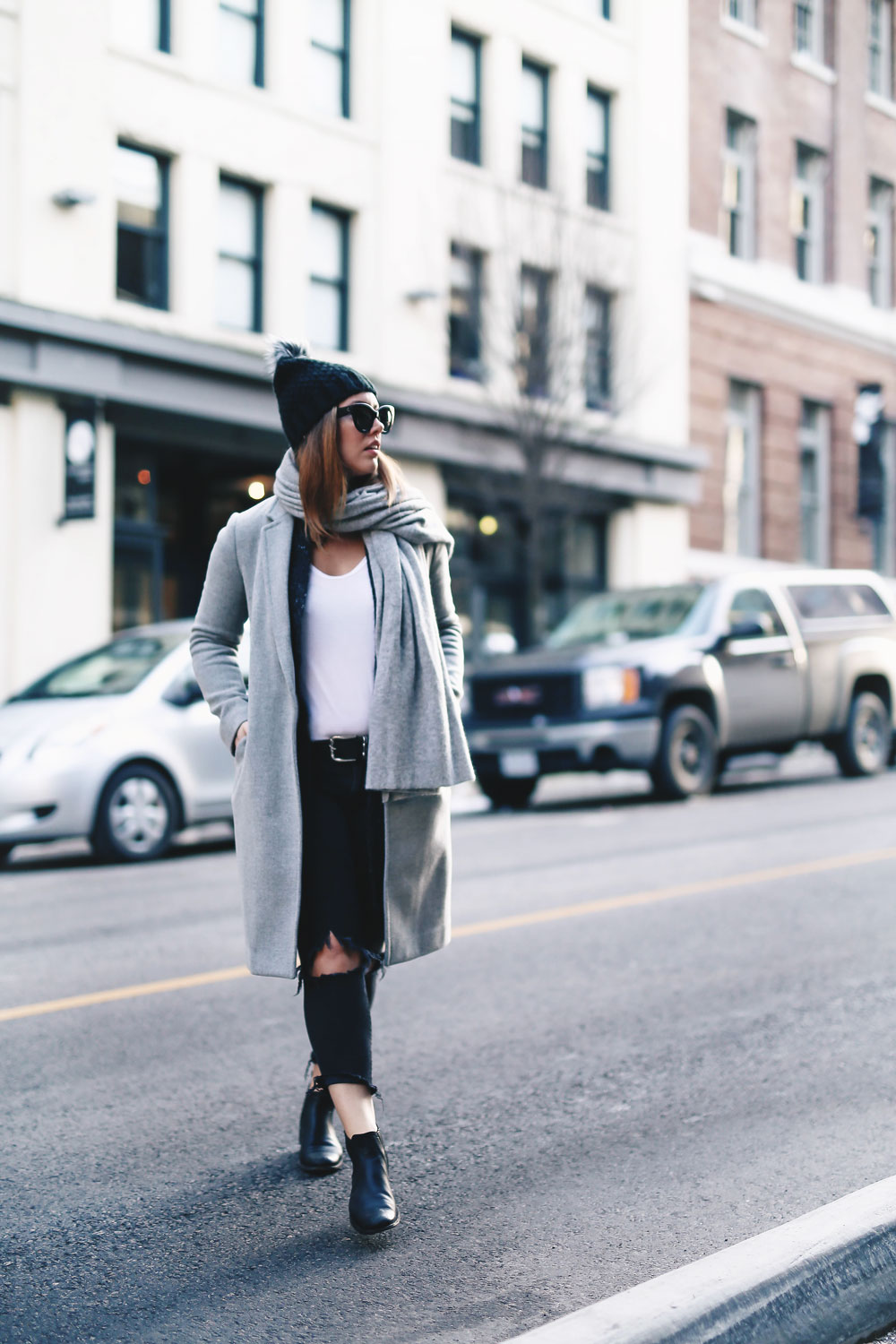 Simple winter outfit idea in Aritzia grey wool coat, White + Warren cashmere coatigan, White + Warren cashmere travel wrap, Express beanie, Frye Chelsea ankle boots, Mavi skinny jeans styled by To Vogue or Bust