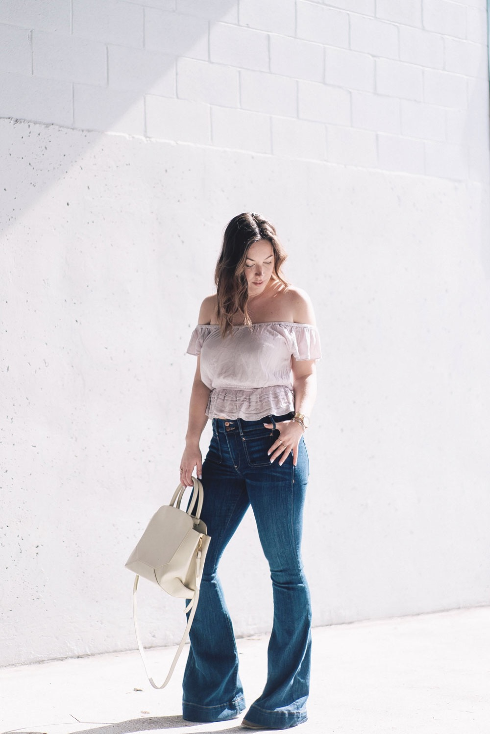 How to wear ruffles, Spring 2017 fashion trends, how to wear off the shoulder tops, Aritzia top, Express flare jeans, how to wear flare jeans by To Vogue or Bust