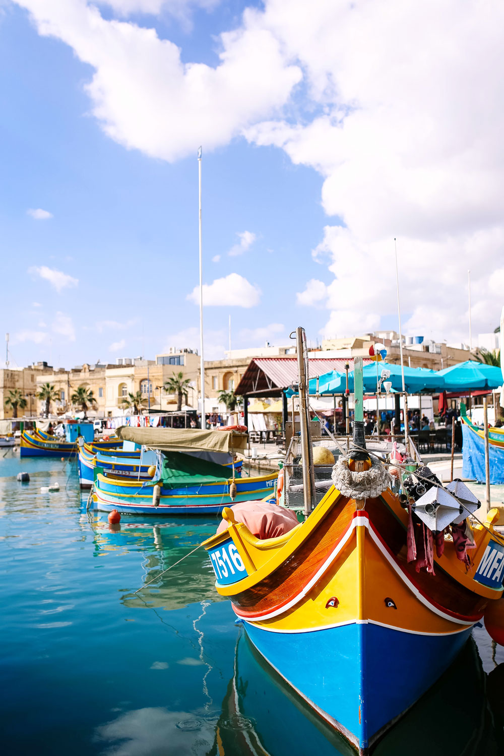 traditional maltese fishing boats by To Vogue or Bust