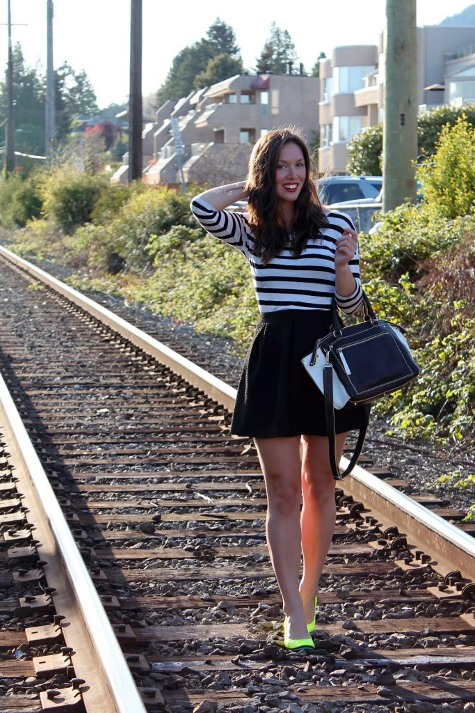 Vancouver fashion and style blogger Alexandra of To Vogue or Bust wears a striped H&M top, H&M skirt, Roots Canada Art Deco Little Brooklyn bag, Tieks Unmellow Yellow ballet flats, Poshllocket necklace.