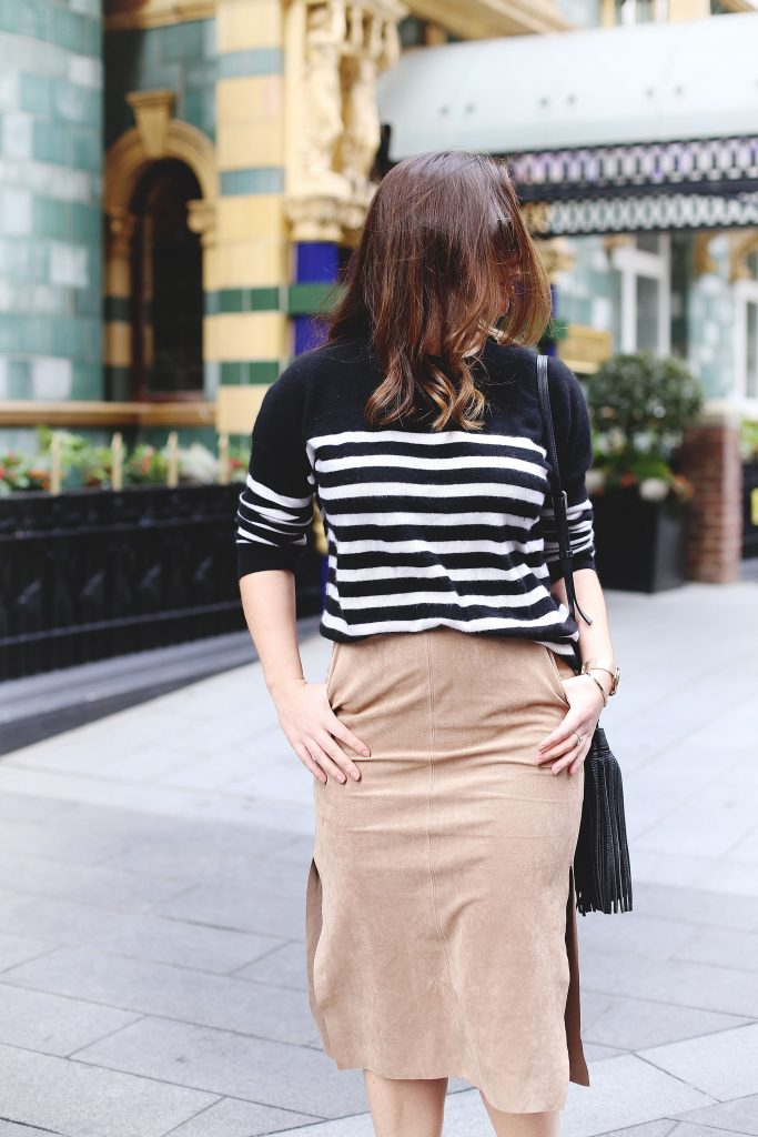 Tan suede skirt, black striped cashmere sweater.