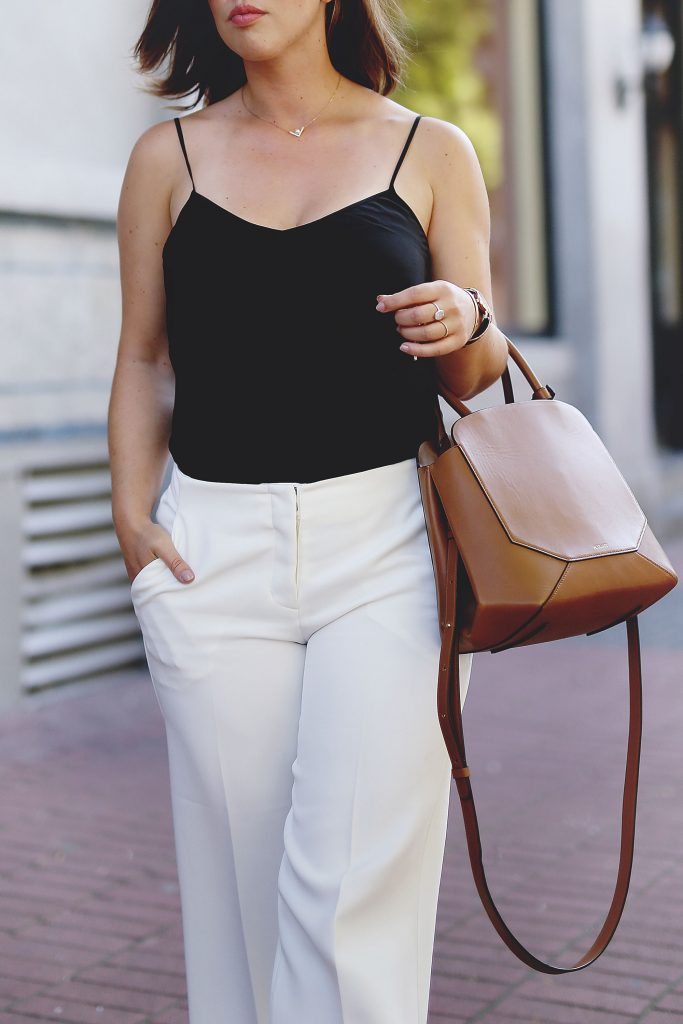 Black silk camisole, white culottes, leather bag