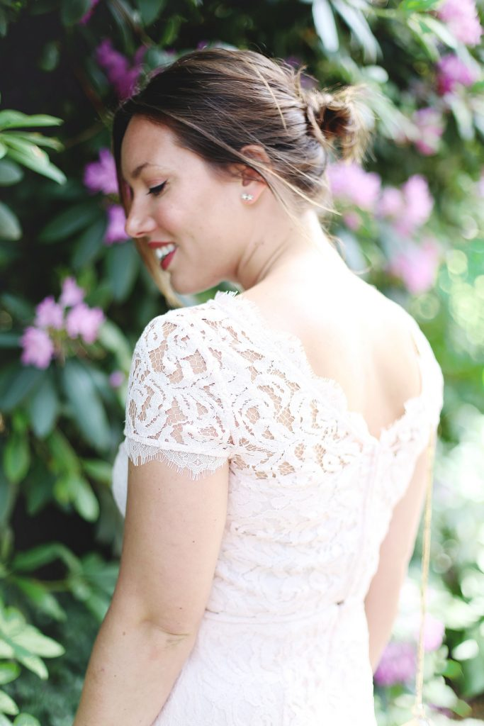 Blush lace wedding guest dress