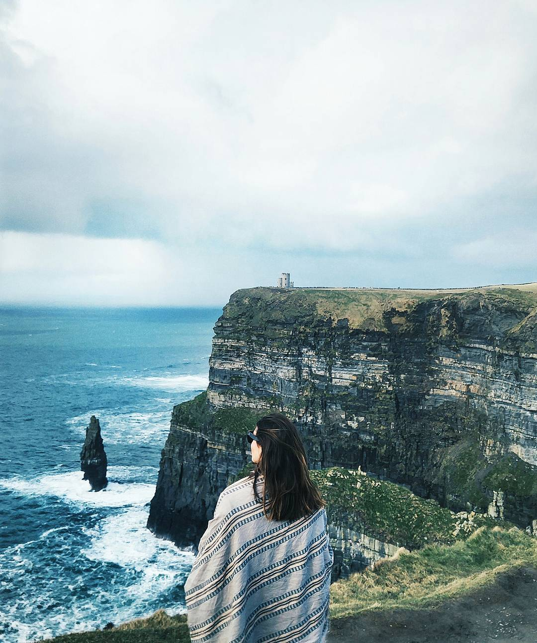 To Vogue or Bust in an Aritzia wrap scarf at the Cliffs of Moher, County Clare, Ireland
