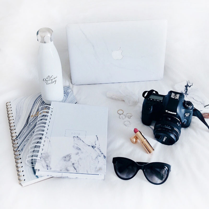Marble MacBook laptop decal, marble notebook, Canon 6D camera, Charlotte Tilbury lipstick in Miranda May, Swell bottle and Leah Alexandra and Swarovski rings