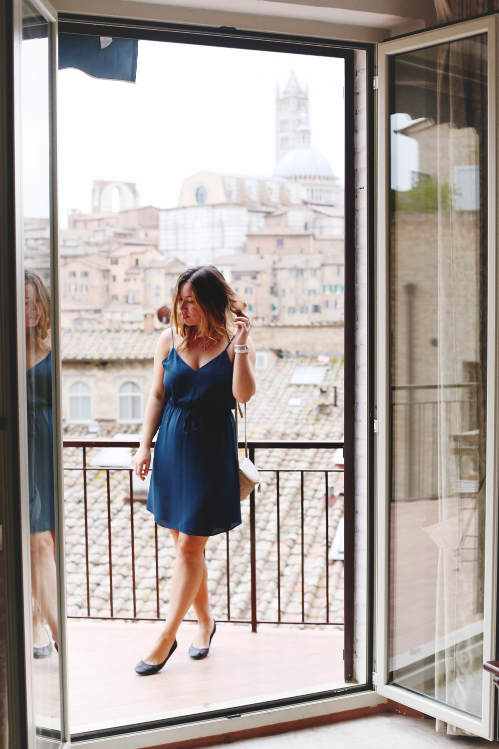 To Vogue or Bust shares jewelry stacking tips in Swarovski jewelry, Aritzia silk dress, Tieks flats and vintage Bottega Venata bag in Siena, Italy