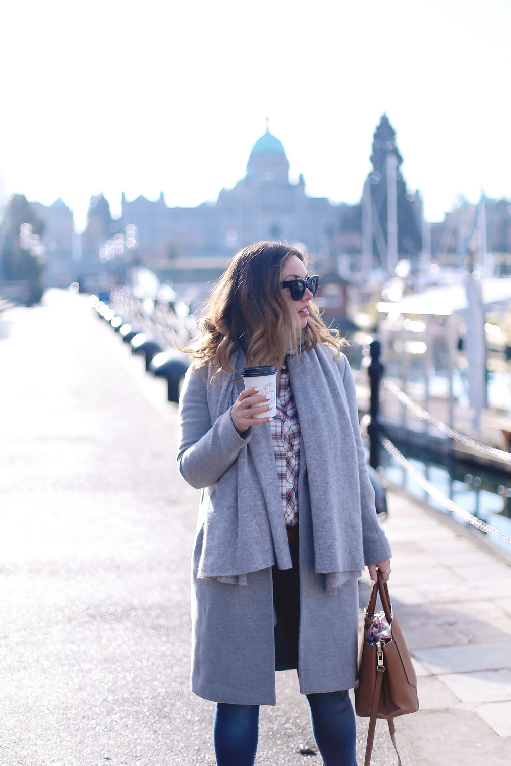 Plaid shirt styling tips in a grey wool coat, grey cashmere scarf, ripped skinny jeans, leather ankle boots and red plaid shirt