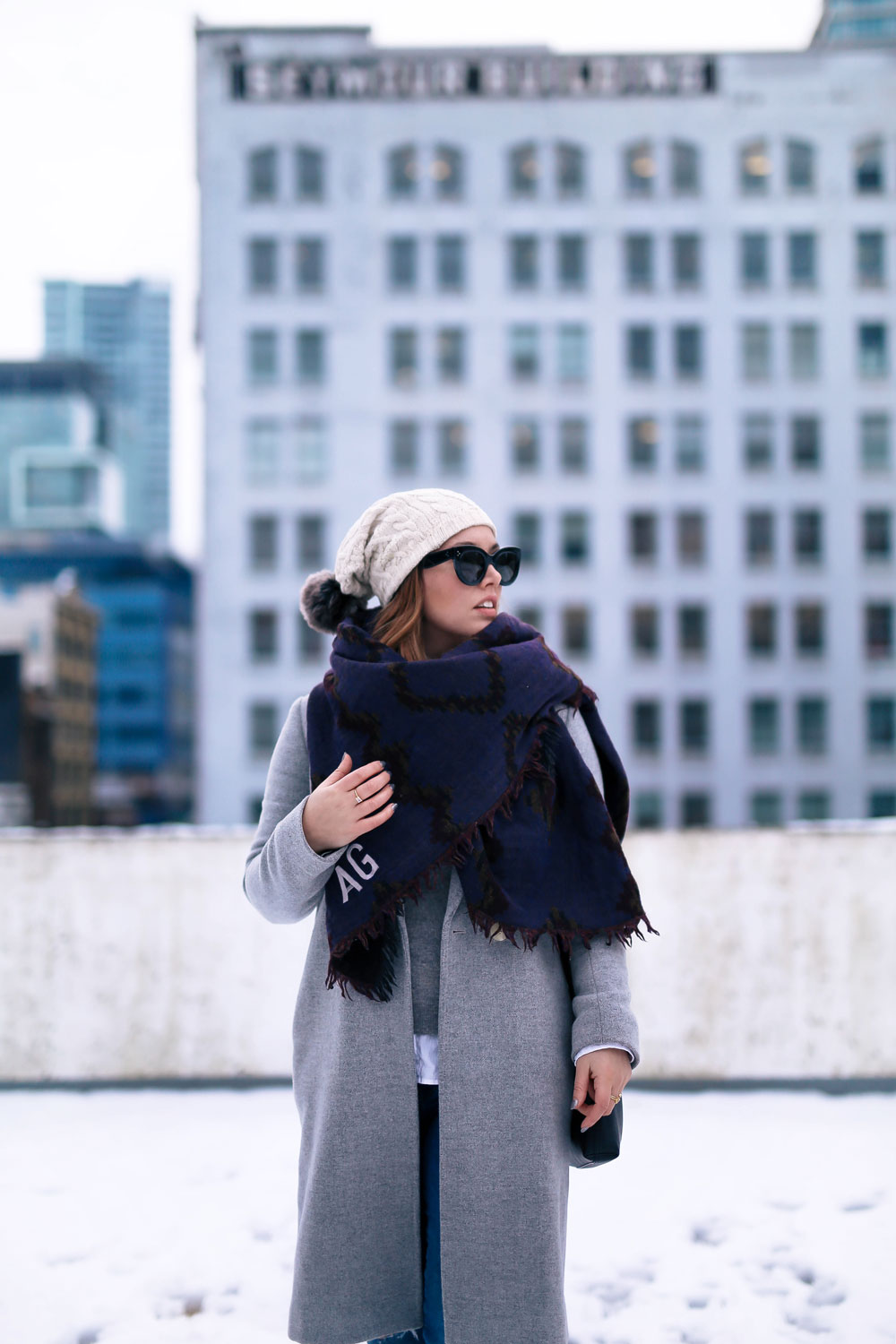 Cute outfit ideas in the snow - Aritzia blanket scarf, Aritzia grey wool coat, Tilley beanie, Mavi skinny jeans, Urban Outfitters ankle boots, Celine Caty sunglasses, layered oxford shirt