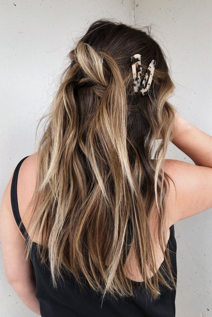 This simple yet chic hairstyle, styled by To Vogue Or Bust is the perfect go-to hairstyle for weddings.
